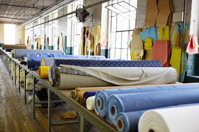 Bolts of fabric in a garment factory