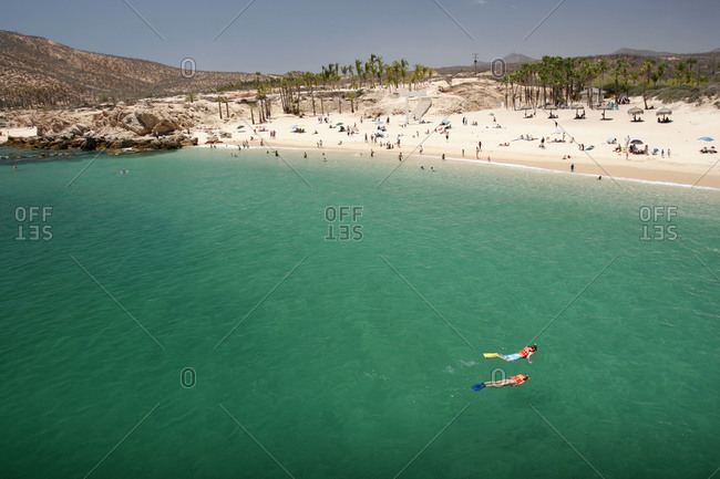 People snorkeling in Chileno bay, Cabo San Lucas, Mexico