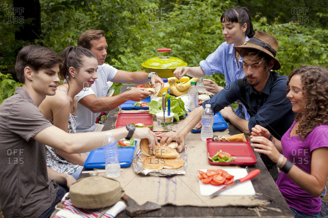 Friends have a picnic at their campsite