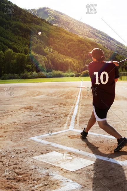 A man swinging a baseball bat