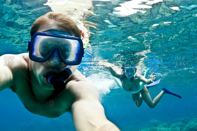 A couple snorkels together