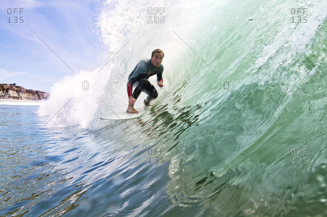 A surfer in the barrel of a wave