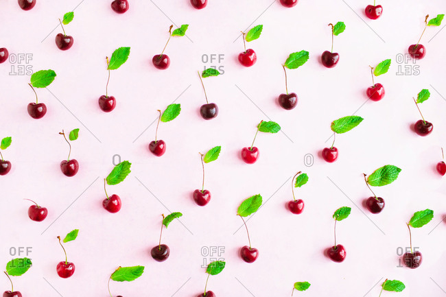 Cherries with stems laid out in pattern