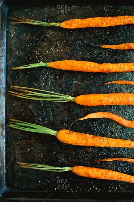 Roasted carrots on baking tray close up