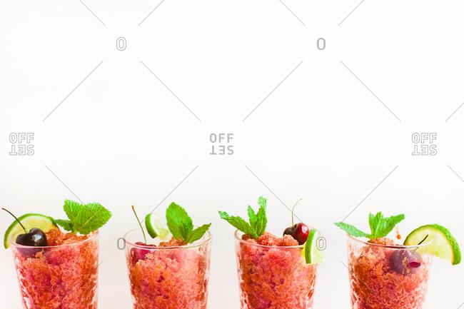 Four glasses of cherry lime granitas
