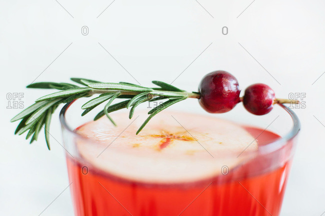 Cranberry cider punch with rosemary garnish
