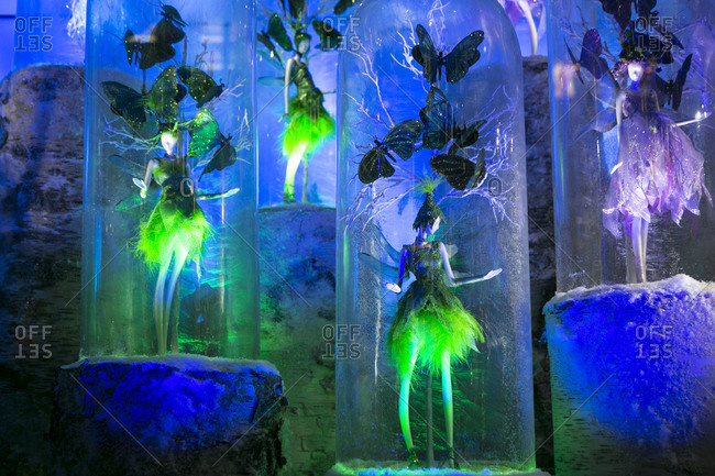 New York City, NY, USA - Circa 2013: Fairies in glass bowls in holiday window display at Lord and Taylor