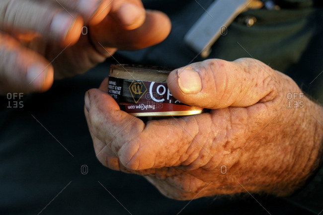 Hobbs, NM, USA - Circa 2009: A man gets some chewing tobacco
