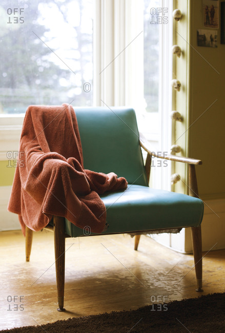 Towel hanging from an armchair