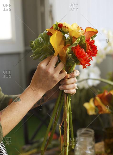 Woman arranging flower bouquet