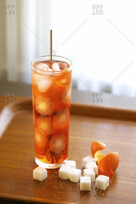 Orange cocktail with sugar cubes