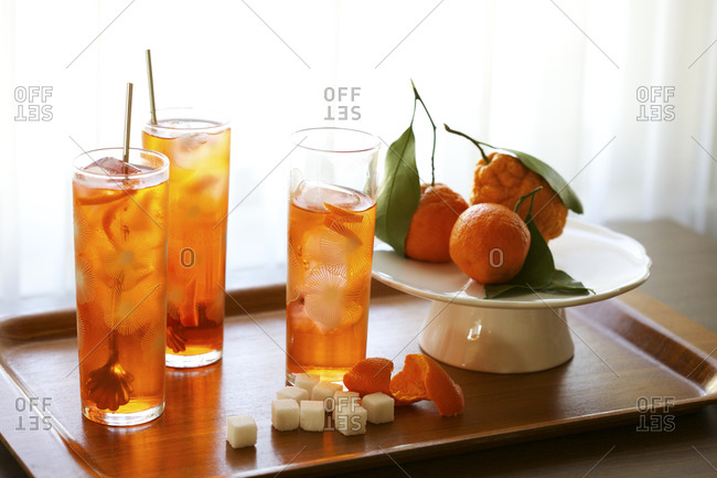 Orange cocktails served on a wooden tray