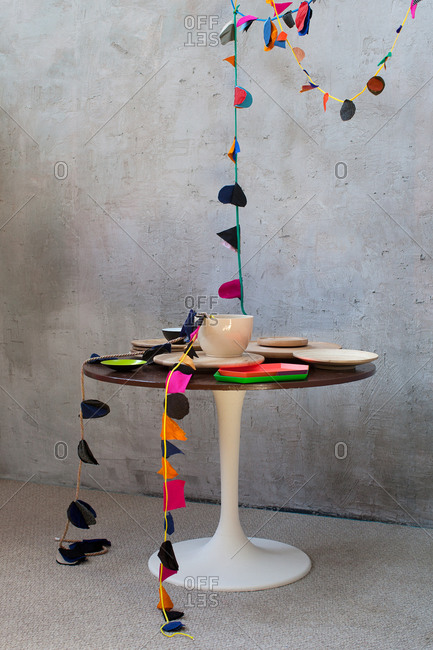 Tulip table with streamers and dishes