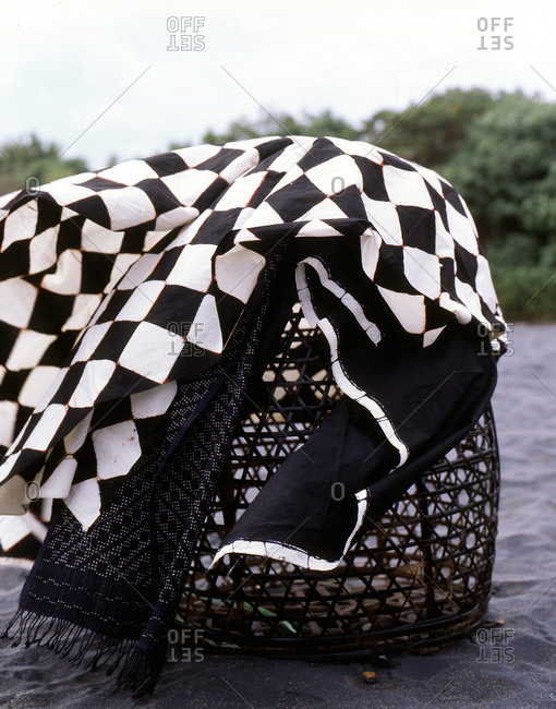 Large basket covered with blankets on beach