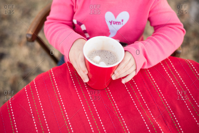 Girl holding a cup of hot chocolate