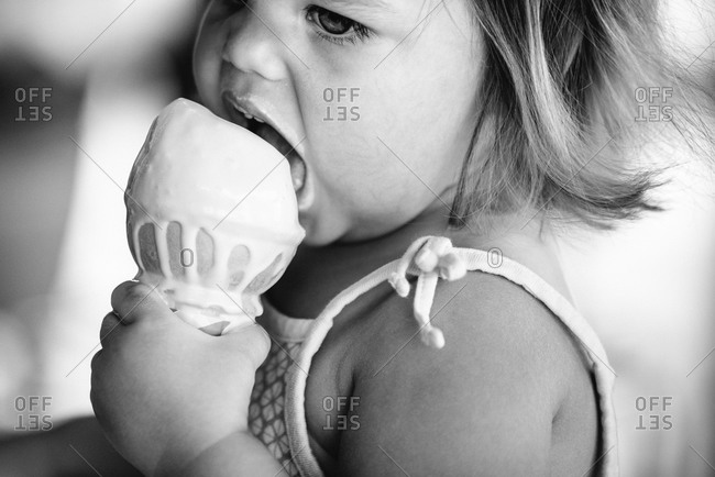 Young girl licking an ice cream