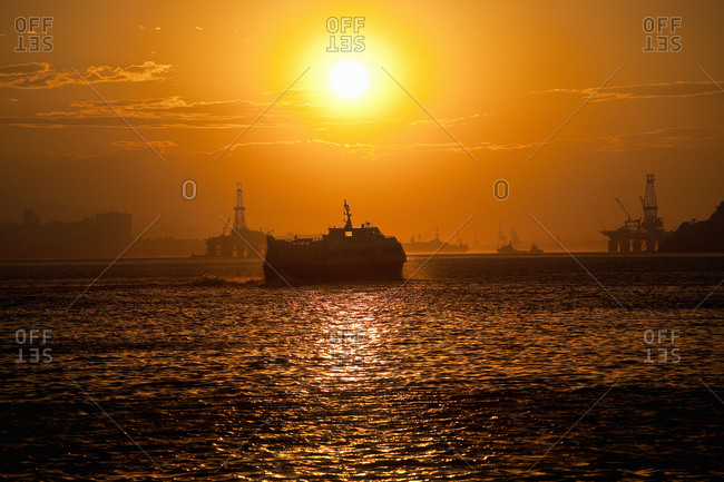 Silhouette of a ship sailing in a Brazilian bay