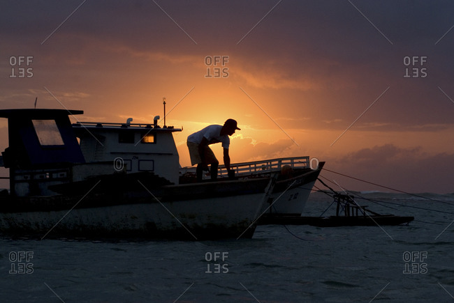 Silhouette of a fisherman at Porto de Galinhas, Brazil