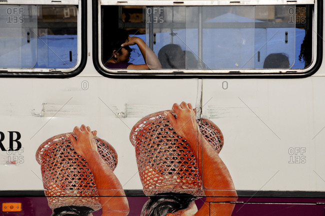 Woman traveling on a bus in Brazil