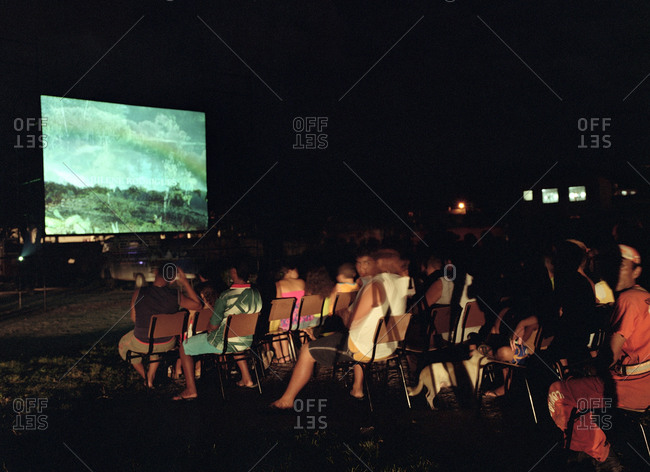 people watching a movie in an outdoor movie theater stock photo offset