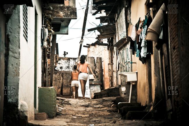 Girls walking in a Brazilian alley