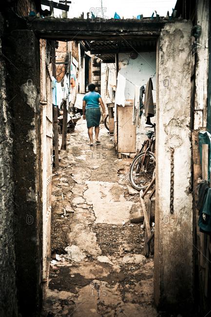 Woman walking in a Brazilian alley