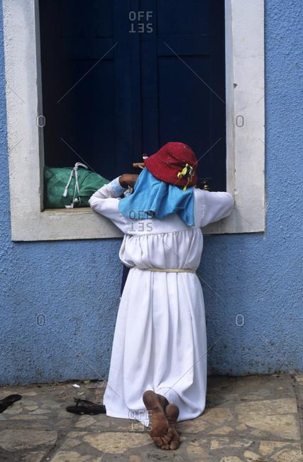 Woman kneeling by window