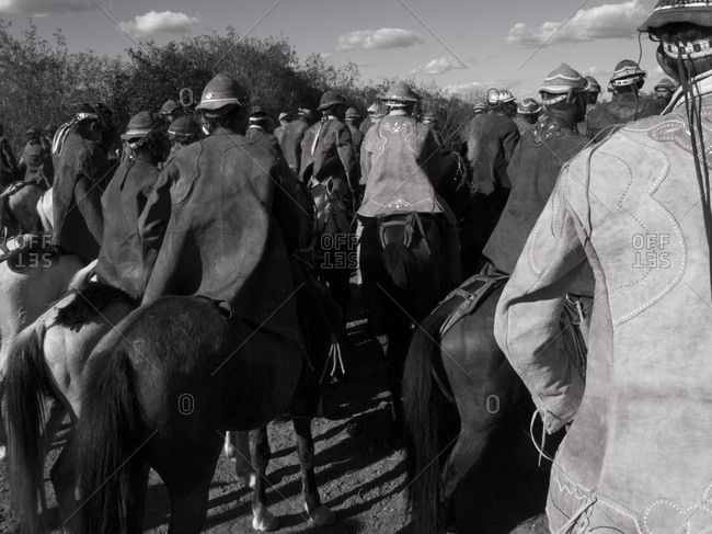 Rear view of cowboys riding horses