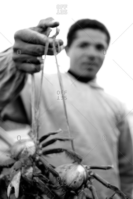Fisherman showing catch