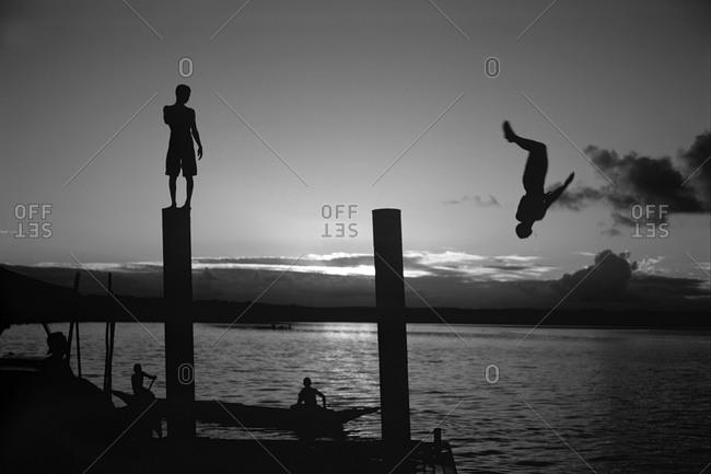 Men having fun in the sea at sunset