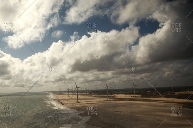 Windmills on a beach