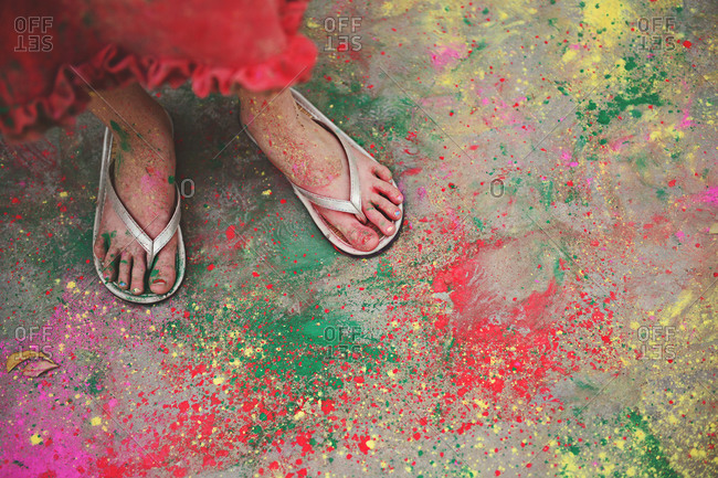 A woman's feet covered in colored paint for the Hindu festival of Holi