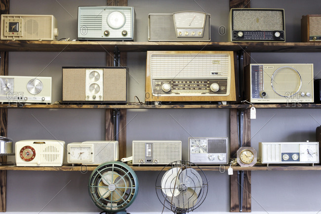 Vintage radios and fans on shelf