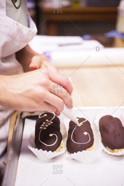 Woman decorating eclairs