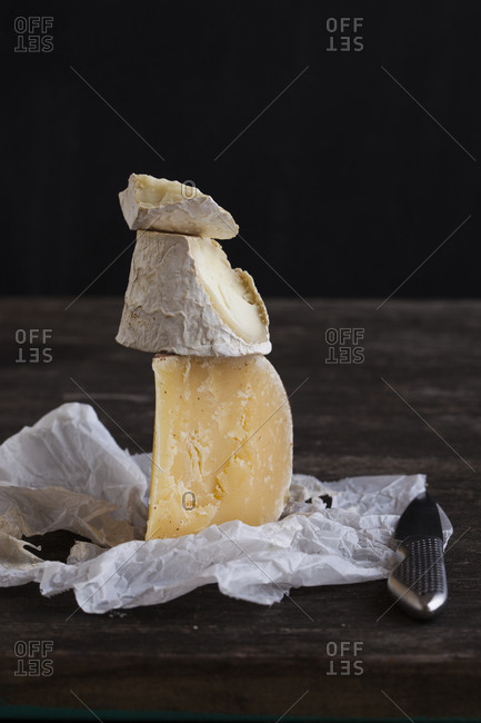 Cheese blocks with a knife on a tabletop