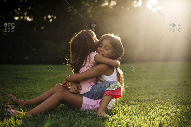 Two sisters hug each other