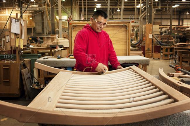 Furniture maker working on a headboard