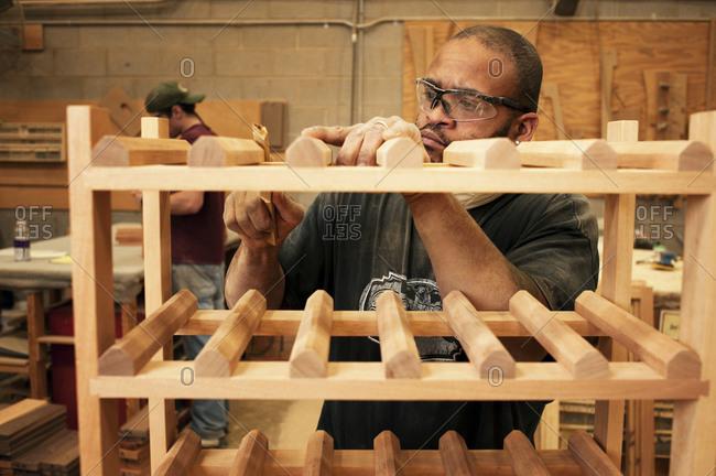 Furniture maker building a wooden rack