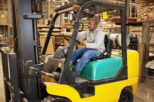 Forklift operator in furniture factory