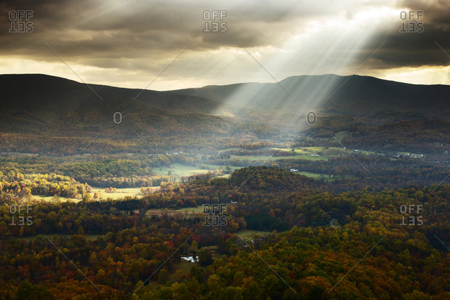 Sun beams shining onto a pastoral landscape