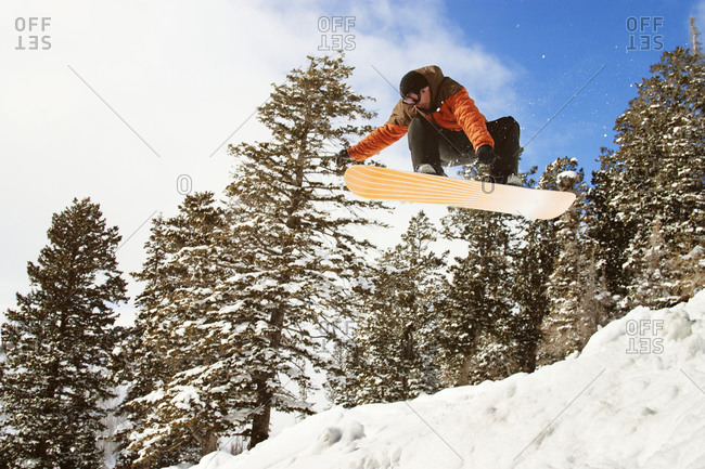 Snowboarder flying off jump