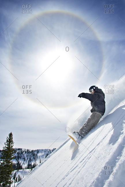 Snowboarder making a steep descent