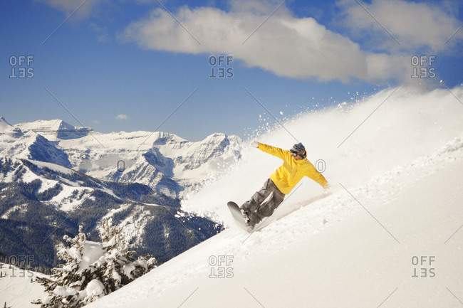Man Carving Down Side of Mountain