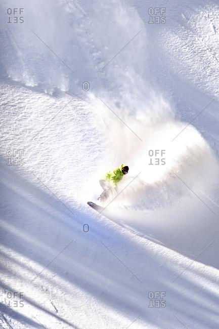 Snowboarder Riding Down Mountain
