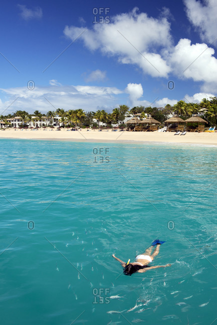 Woman snorkeling offshore from a beach resort