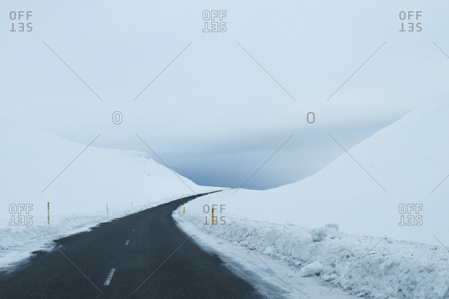 Curving road through snow-covered hills