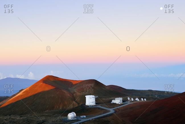 Mauna Kea, Hawaii, USA - January 3, 2015: View to crater and observatories at morning twilight, Hawaii
