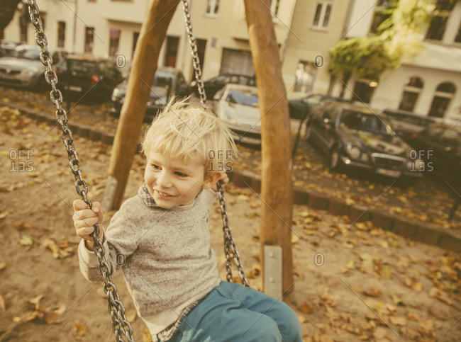 Toddler sitting on a swing