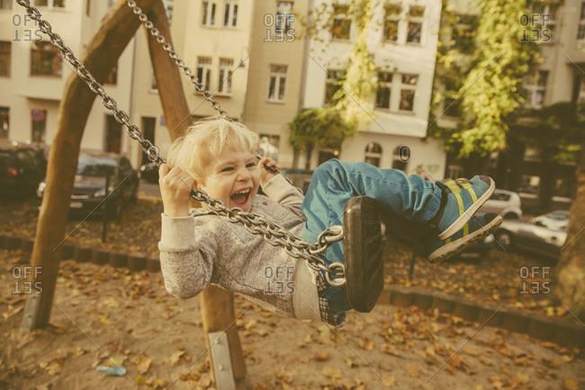 Toddler having fun on a swing