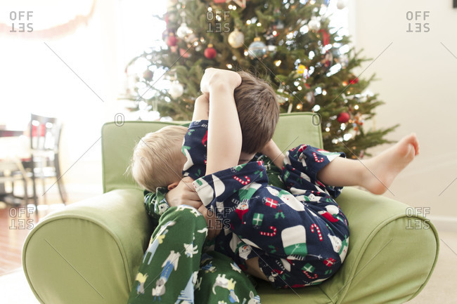 Brothers wrestling in an armchair